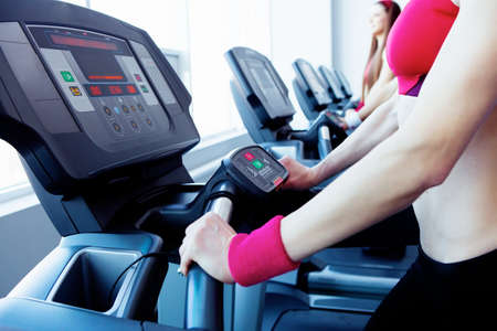 Woman hands on tracking machine in fitness center Stock Photo - 13092066