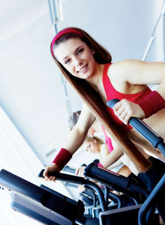 Woman hands on tracking machine in fitness center Stock Photo - 13092029