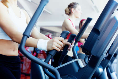 Woman hands on tracking machine in fitness center Stockfoto