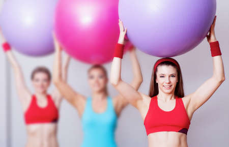 Three girls in fitness club with fitballs photo