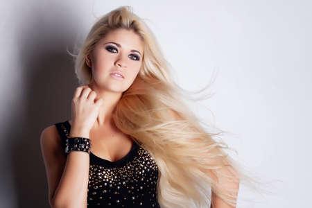 Young beautiful blonde in studio Stock Photo - 13156469