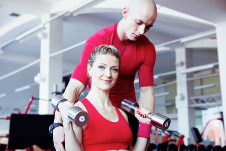 Girl training in fitness club photo