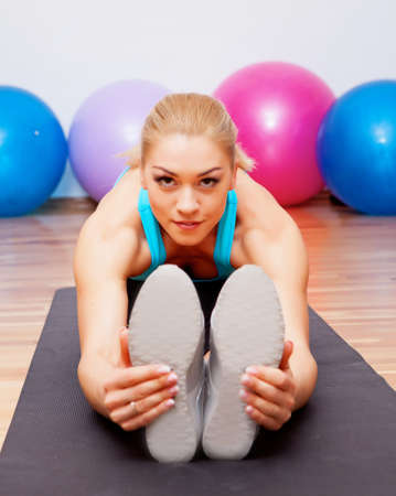 stratching: Girl stratching in fitness club