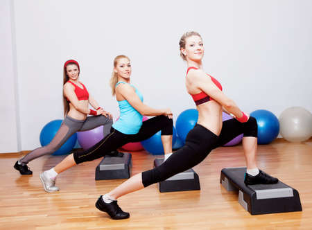 Three girl training in fitness club Imagens
