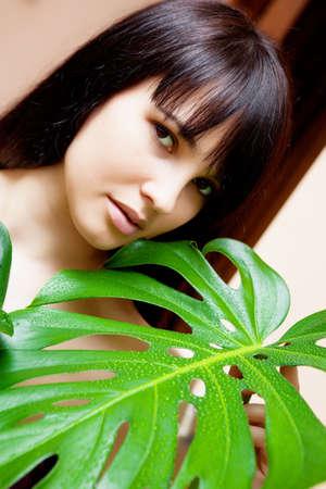 floriculturist: Beautiful brunette girl in garden