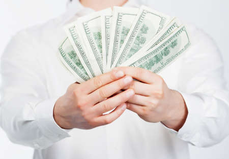 Man holding dollars in hand isolared on white photo