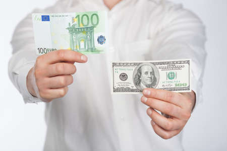 creditor: Man with dollar and euro banknote in hands Stock Photo