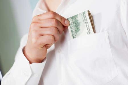Man taking dollars from pocket Banco de Imagens