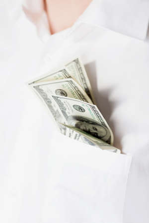 Man with dollars in pocket isolared on white photo