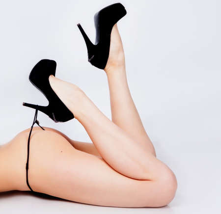 Beautiful girl legs in shoes in studio photo
