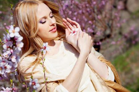Beautiful young woman in peach garden photo