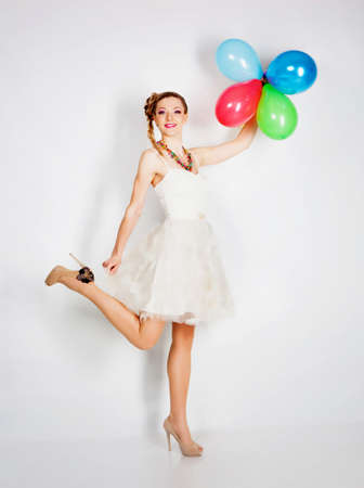 Smiling woman with balloons studio portrait photo
