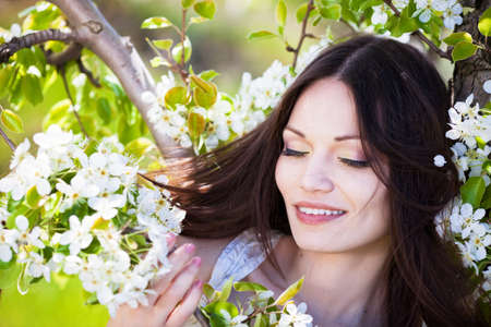 Beautiful brunette hair girl in blossom garden Stock Photo - 13393942