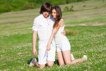 Two lovers on the grass meadow Stock Photo - 13568668