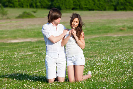 Two lovers on the grass meadow Stock Photo - 13568670