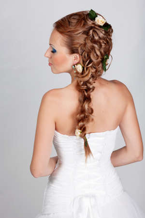 wedding hairstyle: Beautiful blond hair bride portrait in studio