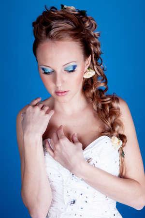 Beautiful blond hair bride portrait in studio photo
