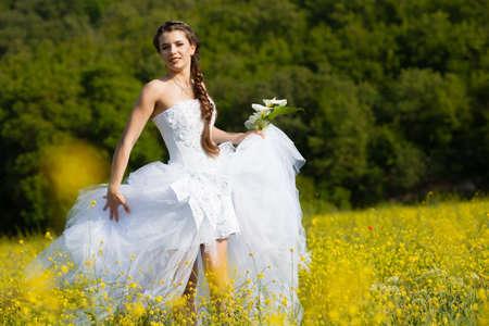 Beautiful brunette bride portrait in summer park Stock Photo - 13648890