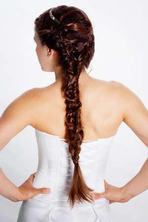 female back: Bride hairstyle photo in studio