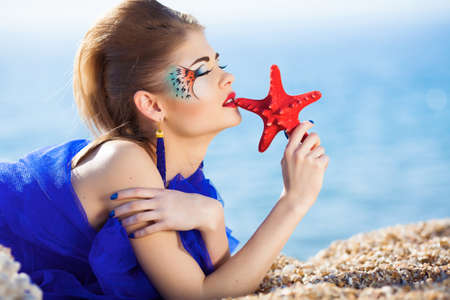 fantasy makeup: Beautiful girl with fantasy make-up on the beach
