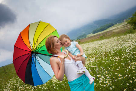 umbrela: Mother with daughter on the camomile meadow