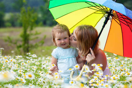 Mother with daugher on the meadow