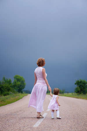 Mother with daugher on the road Stock Photo - 13859375