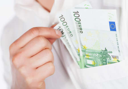 Man holding euro currency in pocket photo