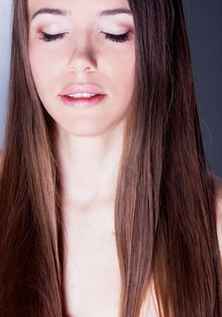 Beautiful brunette girl with healthy hair in studio Stock Photo - 13859256