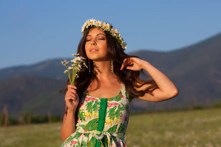 Girl in wreath on camomile meadow Stock Photo - 13902970