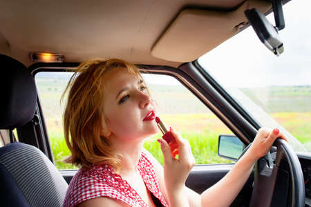 Woman with lipstick in the car photo