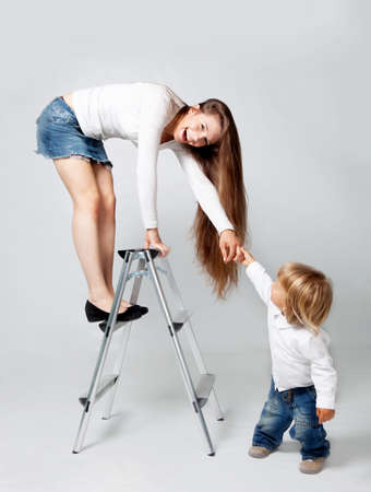 Mother playing with son in studio photo