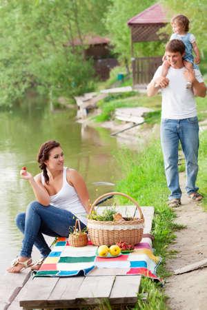 Family on picnic near the lake Stock Photo - 13983086