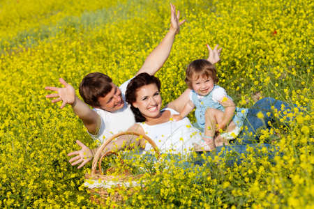 Family on the flower meadow photo
