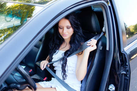 Young beautiful woman in the car photo