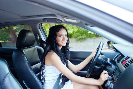 Young beautiful woman driving the car photo