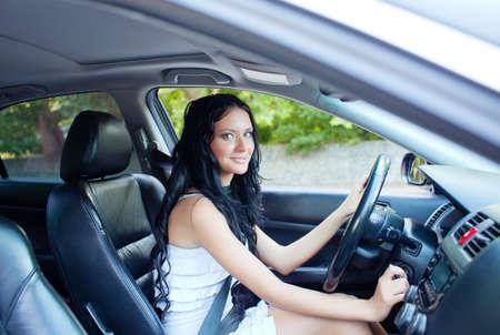 Young beautiful woman driving the car Banco de Imagens