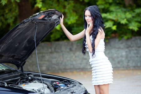 Woman looking to motor of the car Banco de Imagens - 14056854
