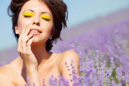 Beautiful girl on the lavender field Stockfoto