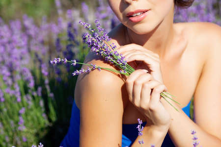 Beautiful girl on the lavender field Stock Photo