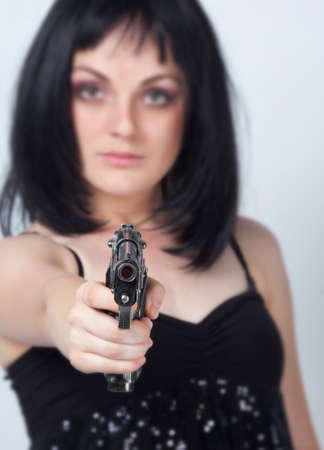 Woman with big gun in hand  photo