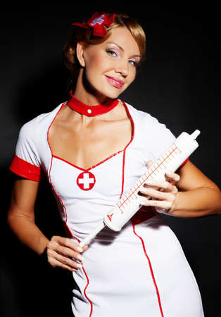 elegant lady  dressed as a nurse photo