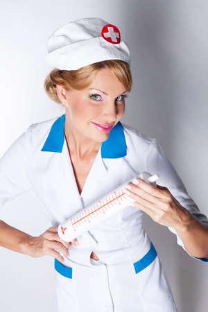 elegant lady  dressed as a nurse isolated on white