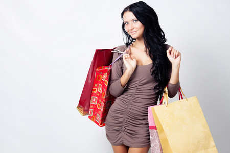 long-haired beautiful girl with bags in the studio Stock Photo - 14310533