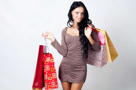 long-haired beautiful girl with bags in the studio Stock Photo - 14310541