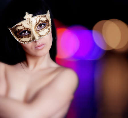 Beautiful brunette girl in mask portrait photo