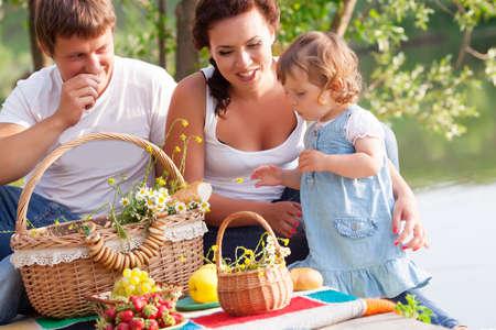 family picnic: Family on picnic near the lake