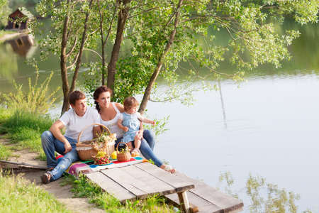Family on picnic near the lake photo