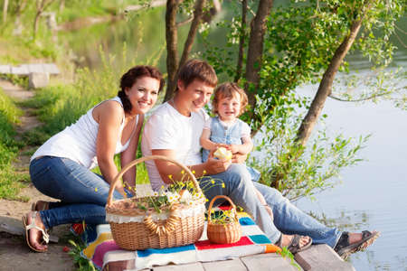 Family on picnic near the lake Stock Photo - 14310855