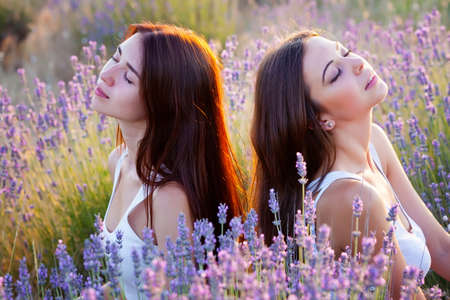 Two girls on the lavender meadow Stockfoto